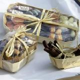 Manojos de tiras de naranja confitadas con chocolate en barquetas de madera Tom Poucea